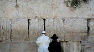 Pope Francis prays during a visit to the Western Wall, Judaism's holiest site, in Jerusalem's Old City, earlier this week. While in the Holy Land, the pontiff extended an invitation to the presidents of Israel and the Palestinian Authority to join a prayer meeting at the Vatican.