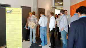 A long line for a men's room at a 2009 tech conference in Omaha, Neb. Photos of this situation have now inspired a Twitter fe