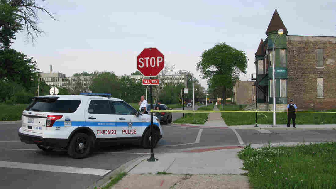 Police cordon off the area around a shooting in Chicago Wednesday. The violence broke out down the street from where NPR's David Schaper was conductin