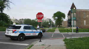 Police cordon off the area around a shooting in Chicago Wednesday. The violence broke out down the street from where NPR's David Schaper was conducting an interview about urban renewal efforts.