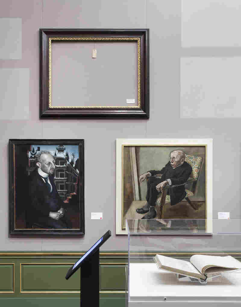 The Neue Galerie exhibit's empty frames represent paintings that were lost or destroyed by the Nazis. They appear beside works that survived Nazi rule, like George Grosz's Portrait of the Writer Max Hermann-Neisse (lower right).