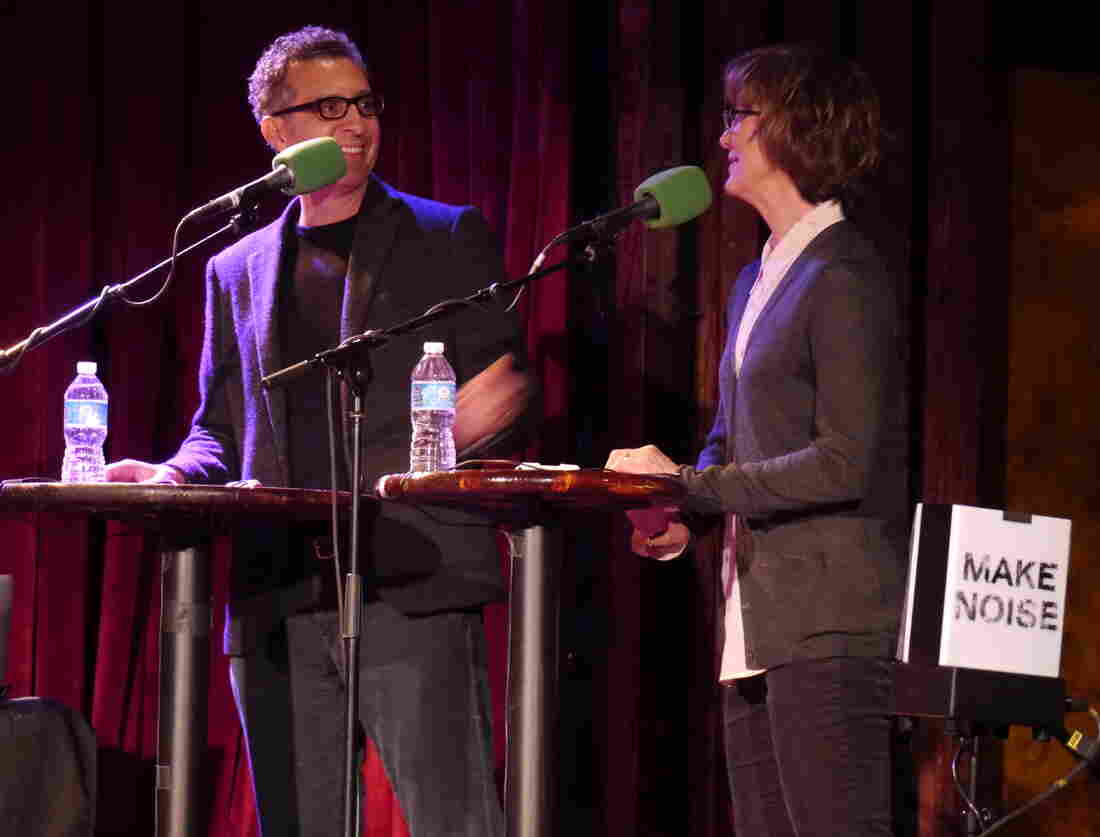 John Turturro turns to his wife, actress Katherine Borowitz, for help during a quiz about the legendary Christopher Walken, on stage at The Bell House in Brooklyn, NY.