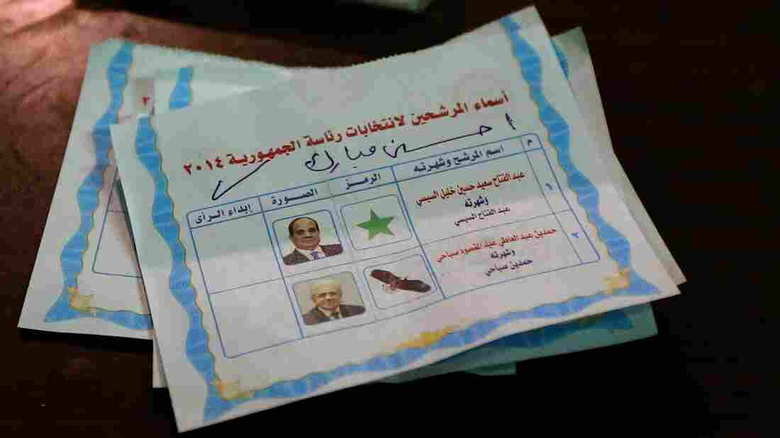 A picture taken in Cairo shows ballots sitting on a table as polling station officials count votes in the country's presidential election. Former army chief Abdel-Fattah el-Sisi is projected to be the overwhelming winner.