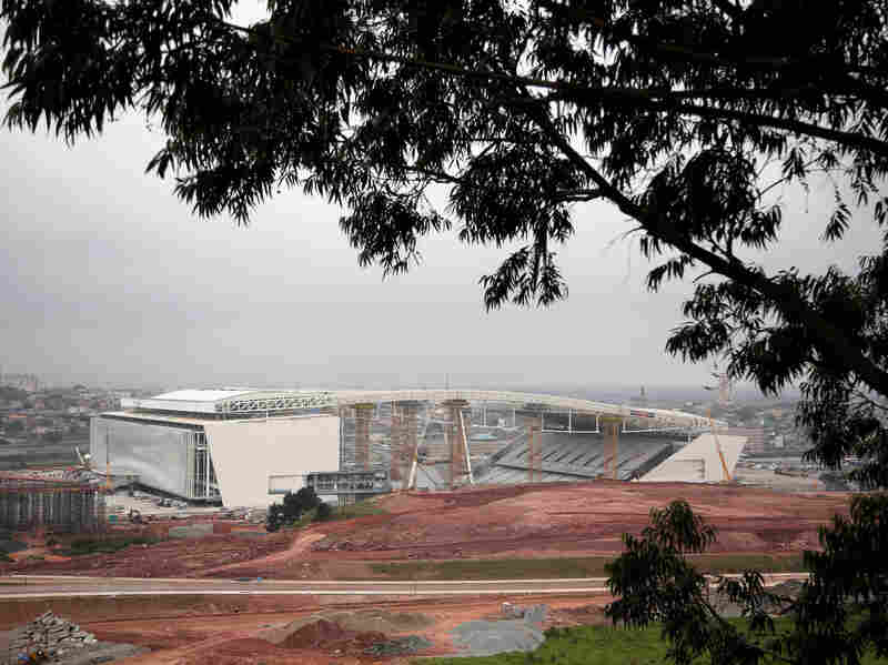 The World Cup will come to the Arena de Sao Paola, shown here when it was under construction last fall. Brazil is also making a big push to control the local mosquitoes that can spread dengue fever.