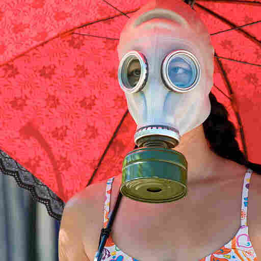 Bathing suit and gas mask.