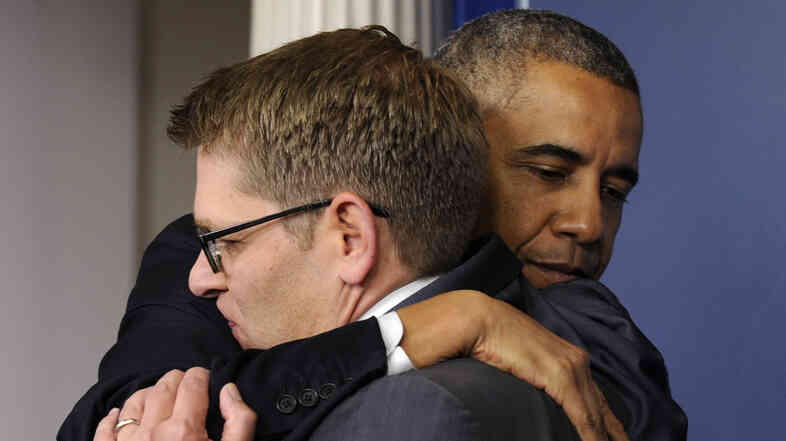 President Obama gives White House press secretary Jay C