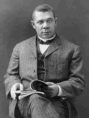 Booker T. Washington sits for a portrait in Hampton, Va., circa 1903.