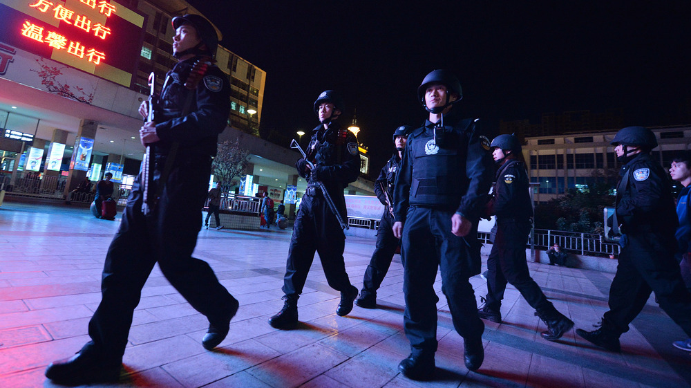 Chinese armed police patrol the main train station in Kunming, in China's southwestern Yunnan province, on March 2. In another attack the Chinese government blamed on Uighur militants, knife-wielding assailants killed 29 people and injured more than 130 in an unprecedented attack at the station.