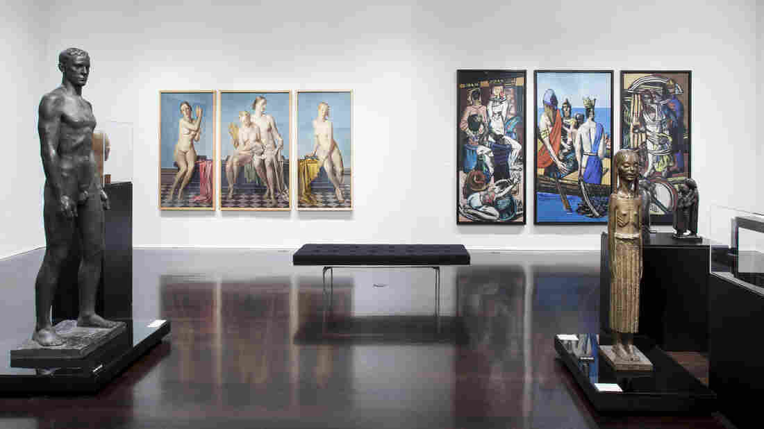 "Max Beckmann's biblical and political triptych Departure (right) hangs on the same wall as Adolf Ziegler's Four Elements triptych, which Hitler owned. Both pieces are part of the Neue Galerie's ""Degenerate Art"" exhibit."