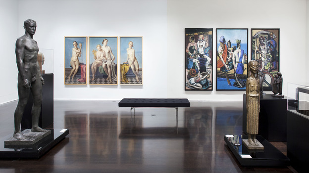"Max Beckmann's biblical and political triptych Departure (right) hangs on the same wall as Adolf Ziegler's Four Elements triptych, which Hitler owned. Both pieces are part of the Neue Galerie's ""Degenerate Art"" exhibit. ( Courtesy of Hulya Kolabas for Neue Galerie New York)"