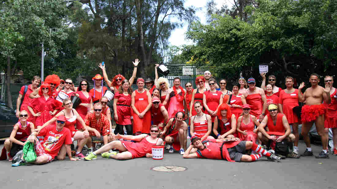 Participants in the Sydney Thirsty Hash House Harriers 2014 Red Dress Run pose for a group photograph. The running group, which has branches all over the world, has roots all the way back to a band of British soldiers in 1938.