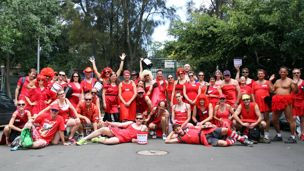 Participants in the Sydney Thirsty Hash House Harriers 2014 Red Dress Run pose for a group photograph. The ru