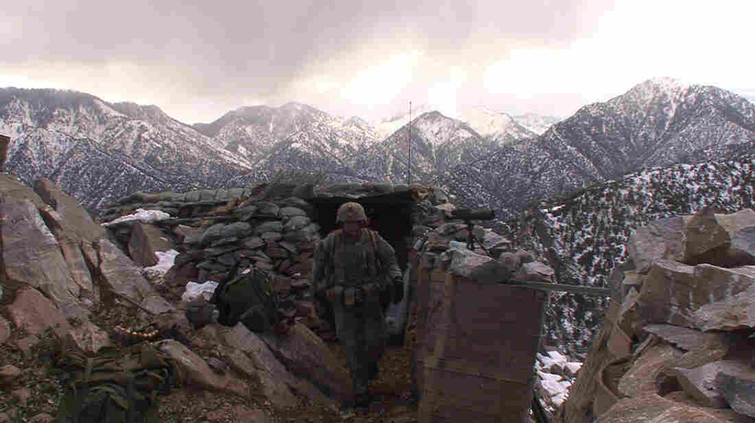 Sgt. 1st Class Mark Patterson checks his men at Outpost Restrepo in Afghanistan, as documented in the new film Korengal.