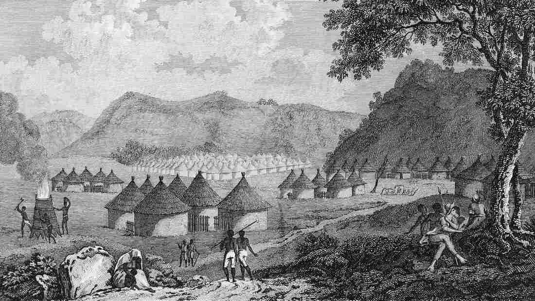 """Scottish explorer Mungo Park was among the first Europeans to view the Mandinka tribe's masked dancers who were known as Maamajomboo. He translated the word as """"mumbo jumbo.' This 1797 illustration from Park's book, """"Travels In The Interior Districts of Africa"""" shows a view of Kamalia village in Mandinka country."""