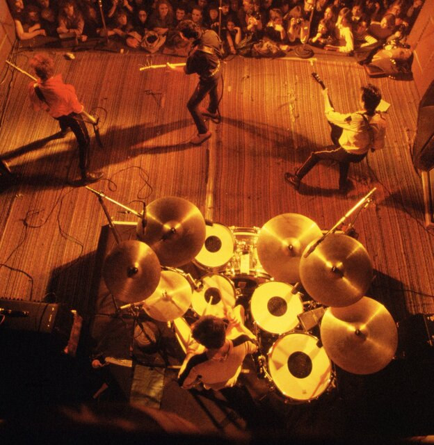 Drummer Topper Headon, seen overhead, with the rest of The Clash, at the band's first U.S. performance, in 1979.