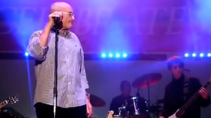 Phil Collins performing at his son's middle school in Miami, Fla.