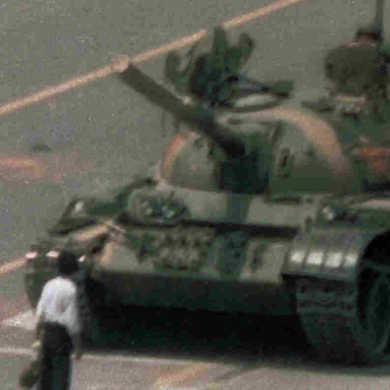 "A Chinese man who became known as ""Tank Man"" stands alone to block a line of tanks heading east on Beijing's Changan Avenue just outside Tiananmen Square on June 5, 1989. It's an iconic image known around the world --€"" except in China."