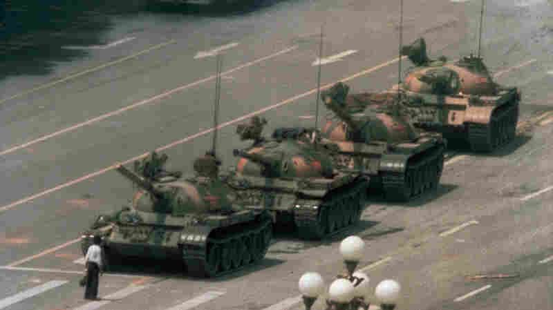 """A Chinese man who became known as """"Tank Man"""" stands alone to block a line of tanks heading east on Beijing's Changan Avenue just outside Tiananmen Square on June 5, 1989. It's an iconic image known around the world --€"""" except in China."""