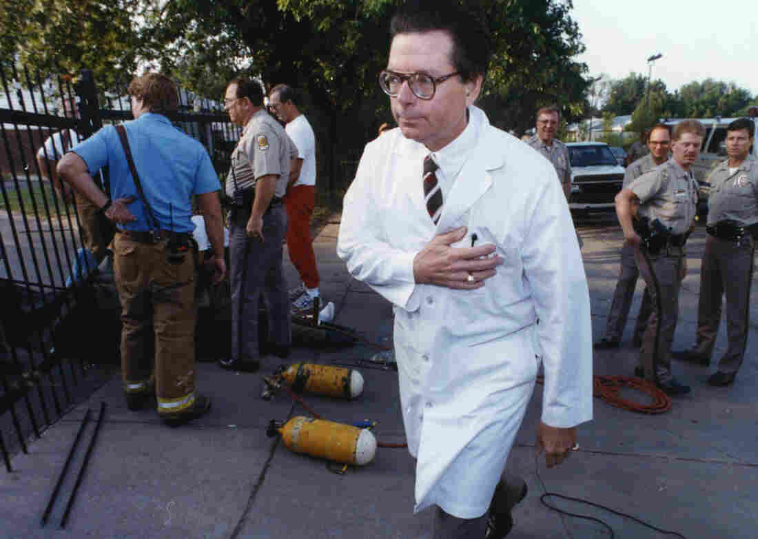 Dr. George Tiller outside his clinic in 1992 after four people locked themselves to the entrance gates of his clinic.