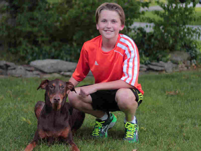 Charlie Hall with his dog Rosie, the subject of his science project.