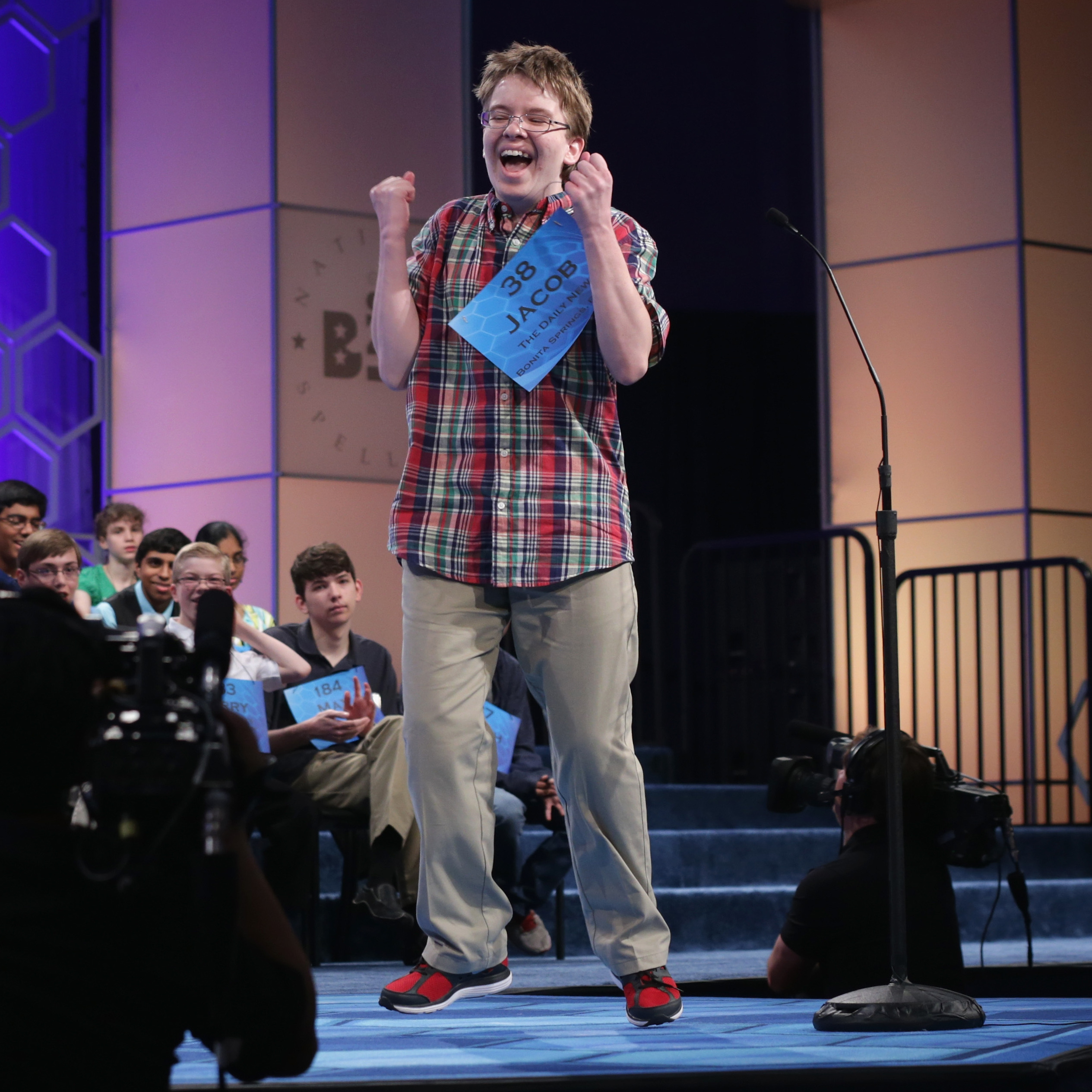 Speller Jacob Daniel Williamson of Cape Coral, Fla., reacts after he correctly spelled a word during round five of the 2014 Scripps National Spelling Bee competition Thursday. He made it to the finals -- and won fans with his enthusiasm.