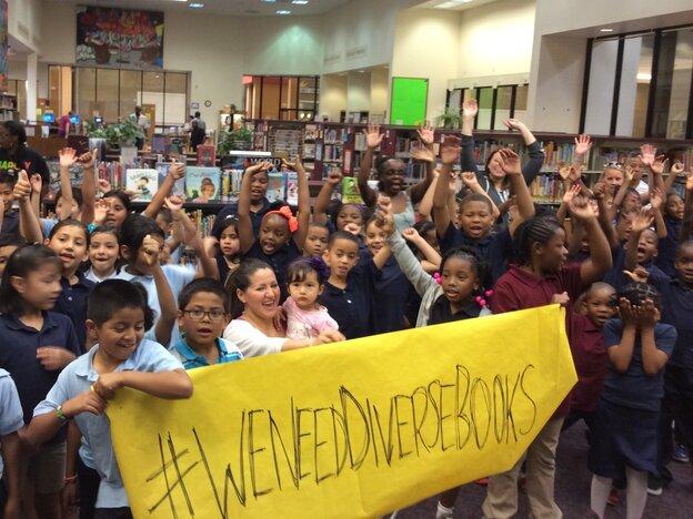 Children at Oakland Public Library in California participate in the #WeNeedDiverseBooks campaign.