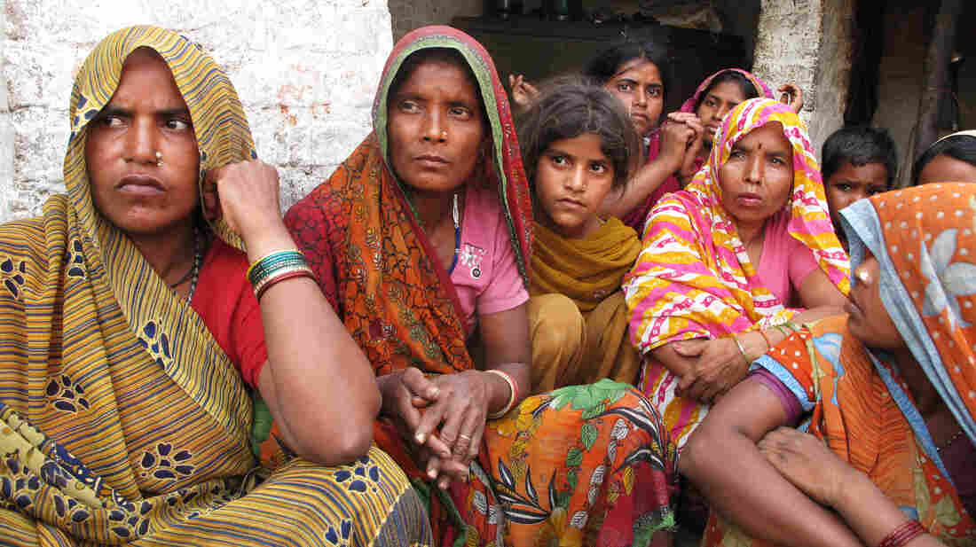 Women gather in the courtyard at the home of the two young victims' family in the village of Katra Sahadatganj in the northern Indian state of Uttar Pradesh.  India's largest state is under pressure to address atrocities against women.