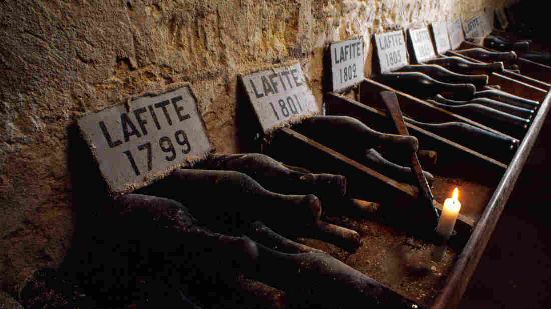 Bottles of vintage wine dating back to the end of the 18th century are carefully labeled and stored in the cellars of Chateau Lafite Rothschild, Bordeaux, France.