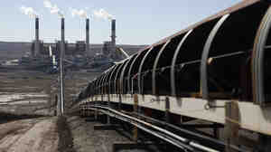 The EPA is proposing rules that would govern carbon dioxide gas emissions by U.S. power plants. Here, coal is transported via conveyor belt to the coal-fired Jim Bridger Power Plant outside Point of the Rocks, Wyo., in March.