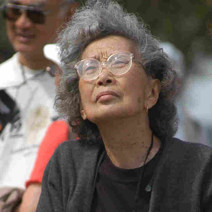 Yuri Kochiyama looks at a memorial for World War II Japanese-American internees at the Rohwer Relocation Center in Rohwer, Ark., in 2004.