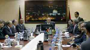 Palestinian Prime Minister Rami Hamdallah (center) leads the first Cabinet meeting of the new Palestinian unity government in the West Bank city of Ramallah on Tuesday.