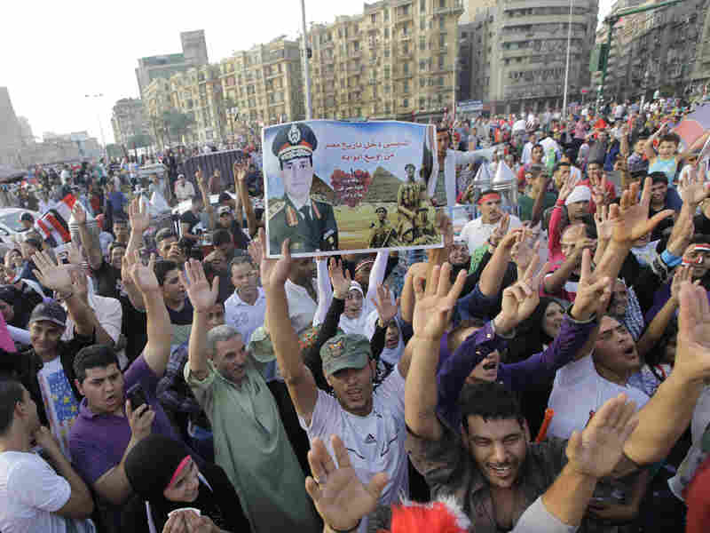 Egyptian supporters of Abdel-Fattah el-Sisi chant slogans during a celebration in Cairo's Tahrir Square last week. On Tuesday, election officials certified that Sisi secured 97 percent of the vote.