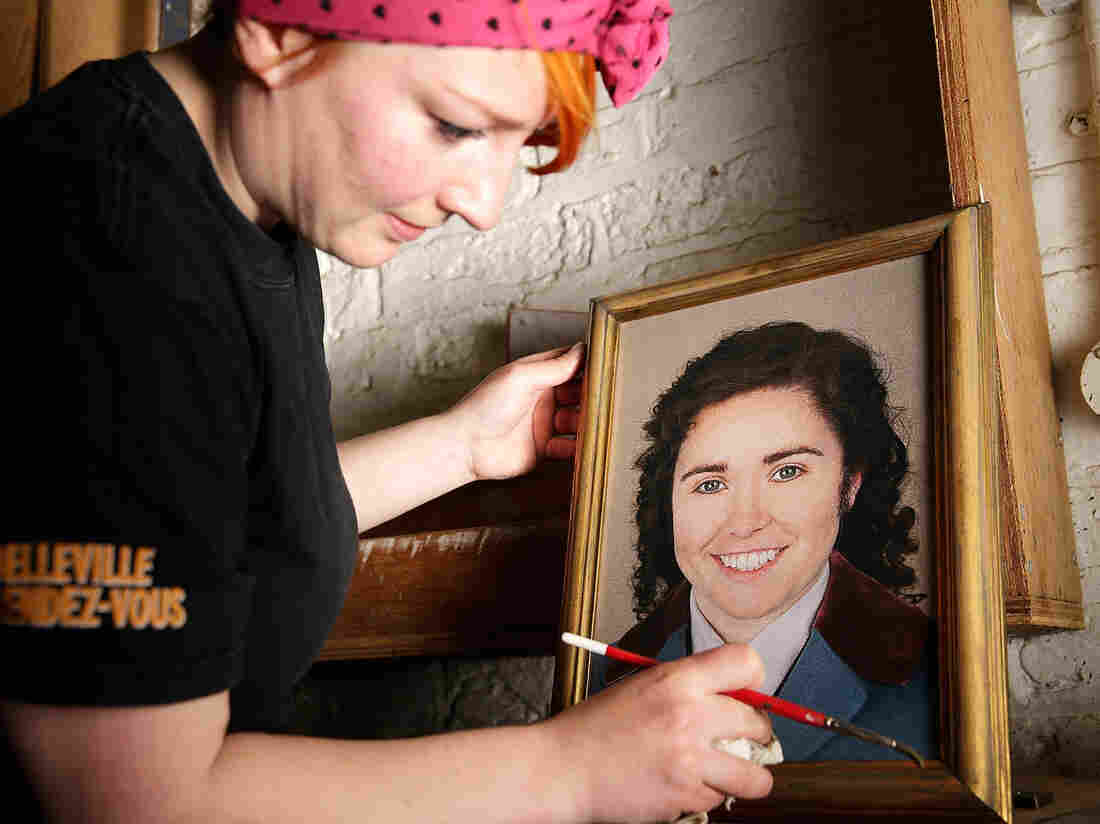 A prop maker readies a portrait of Octavian (Tara Erraught) in advance of the first performance of Der Rosenkavalier at the Glyndebourne Festival last month.