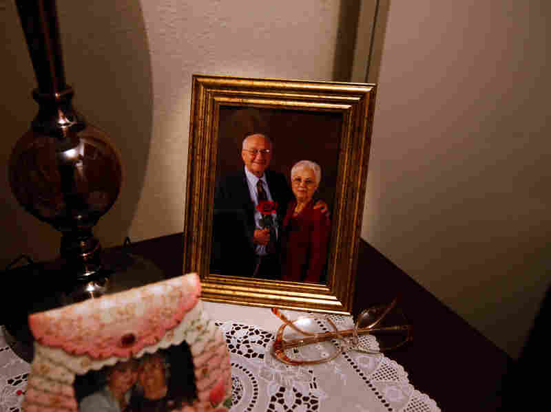 A photograph of John Huckleberry and his wife, whom he met while still in prison, adorns a table in the couple's home.