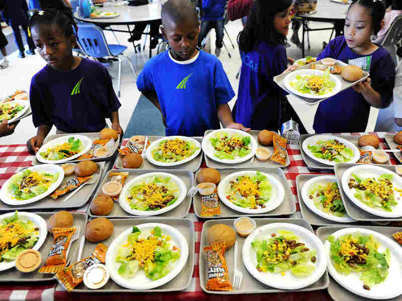 SOAR Charter school in Denver, Colo., is one of many schools that's serving more vegetarian meals. Keshan Pride, 6 (in blue), looks over his choices during lunchtime in 2011.