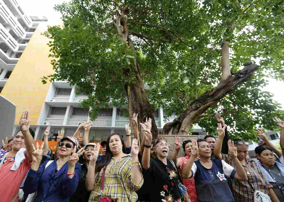 Thai protesters demonstrate during an anti-coup rally at Thammasat University in Bangkok on Sunday. At least two protesters were arrested as thousands of soldiers and police were deployed in Bangkok to thwart sporadic protests against the May 22 coup.