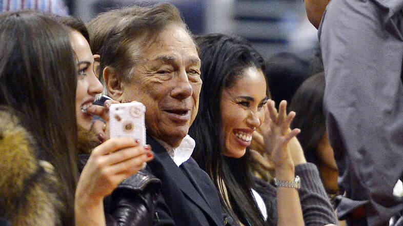 Donald Sterling watches his Los Angeles Clippers play the Sacramento Kings in October. Sterling's attorney says he has agreed to sell the team.