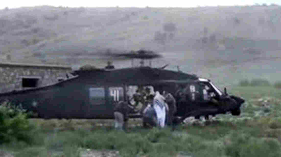 A video released by the Taliban shows Sgt. Bowe Bergdahl being bundled into a U.S. helicopter in eastern Afghanistan on Saturday.