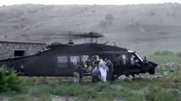 A video released by the Taliban shows Sgt. Bowe Bergdahl being bundled into a U.S. helicopter in ea