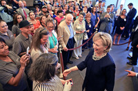 Hillary Clinton works a rope line at Intertech Plastics in Denver on Monday.