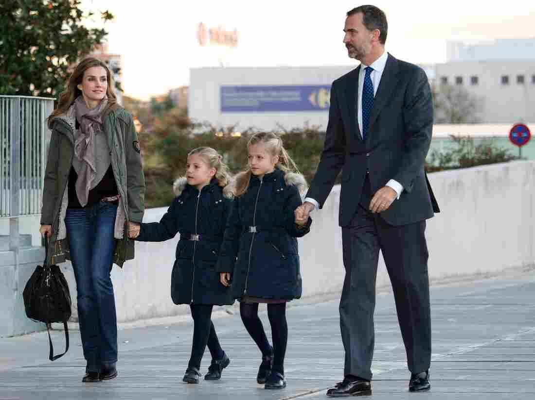 Letizia and Felipe, with their daughters Sofia (left) and Leonor, visit King Juan Carlos of Spain at the Quiron University Hospital in November. The king abdicated on Monday.
