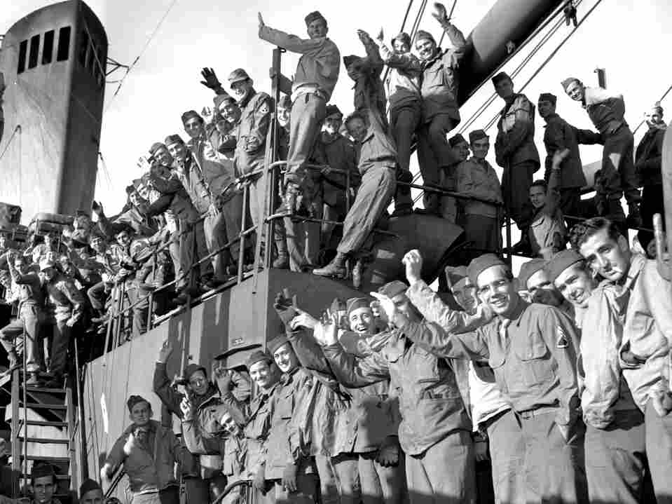 Soldiers returning from the Pacific wave from the deck of the USS General Mitchell on Dec. 11, 1945. Much of the health care demand i