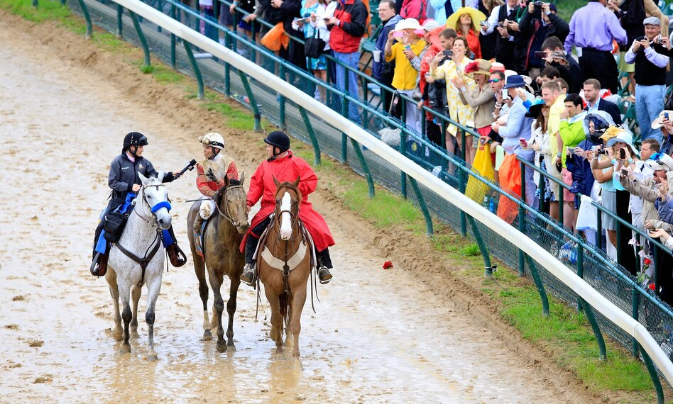 Donna Barton Brothers (left) interviews Kentucky Derby-winning jockey Joel Rosario at Churchill Downs on May 4, 2013, in Louisville. (Getty Images)