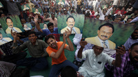 Thousands of supporters of Altaf Hussain began a sit-in in Karachi on Tuesday shortly after he was detained in London for questioning on suspicion of money laundering.