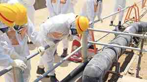Members of a local government council check an outlet of a so-called groundwater bypass system as they inspect the crippled Fukushima Dai-ichi Nuclear Power Station earlier this week.