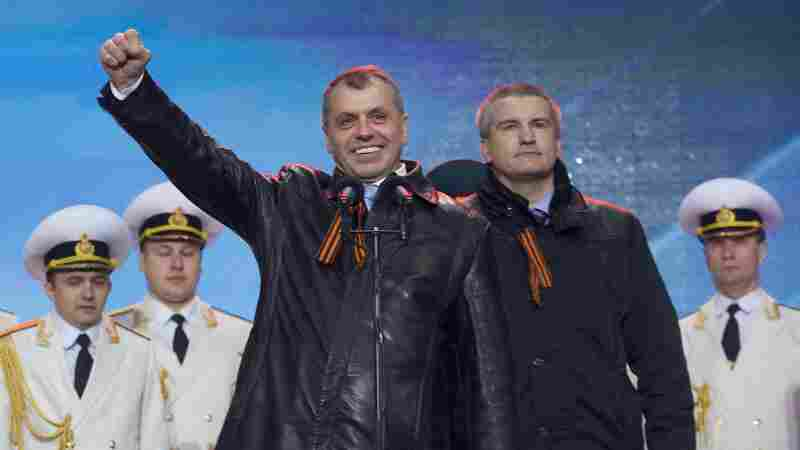 Crimea's new prime minister, Sergei Aksyonov (right), and the speaker of the legislature, Vladimir Konstantinov, attend a rally at Red Square in Moscow on March 18, the day Russia annexed the territory. Russia is pumping billions into Crimea after taking it from Ukraine. However, corruption has been a major problem in Crimea.