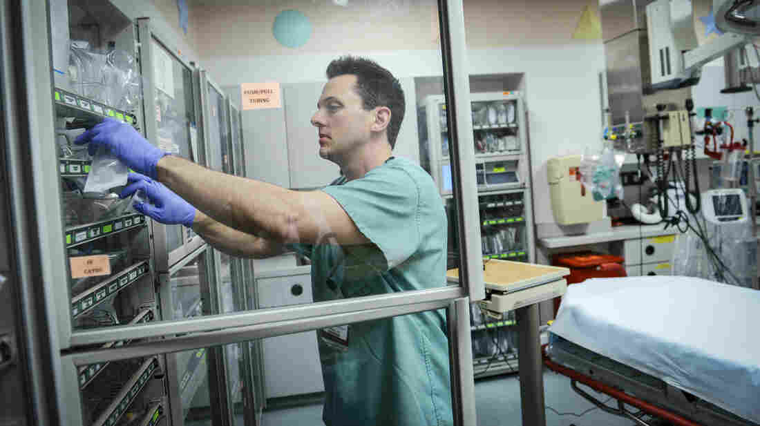 Brian Micalizzi, a pharmacist at Children's Medical Center in Dallas, prepares an antibiotic prescribed to a patient in the emergency department.