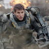 Tom Cruise as Maj. William Cage, a soldier who's woefully unprepared for battle, in Edge of Tomorrow.