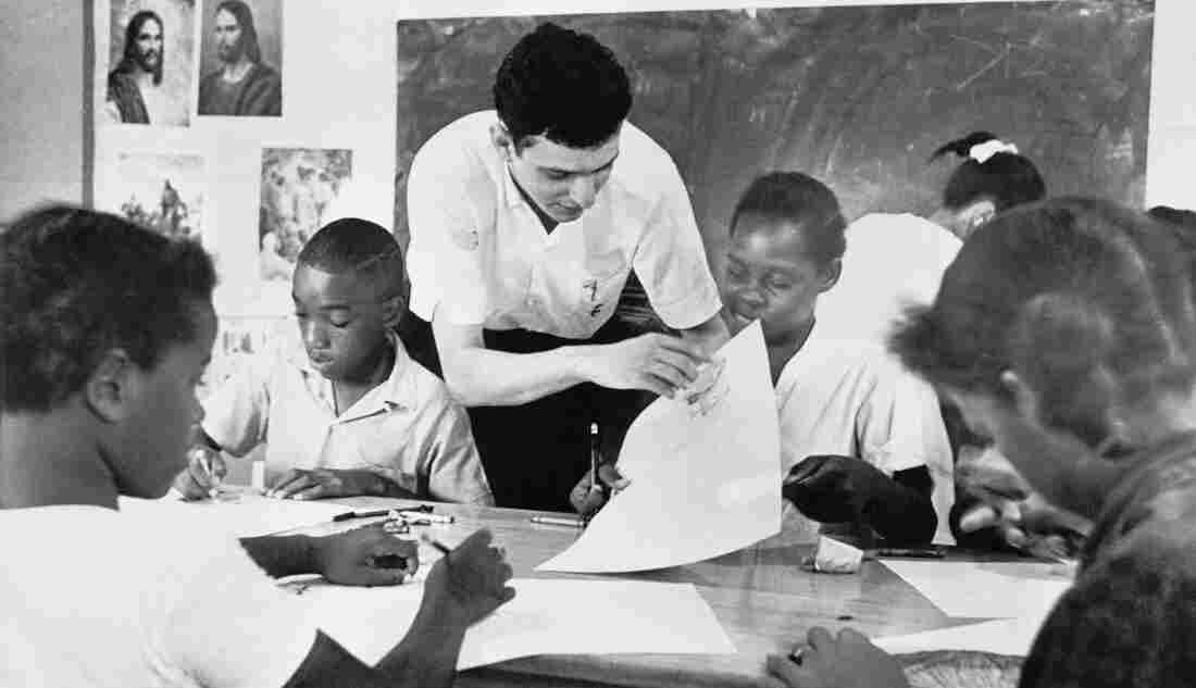 Bruce Solomon, 24, a New York volunteer with the Mississippi Summer Project, teaches a class of African-American children in Jackson in 1964.