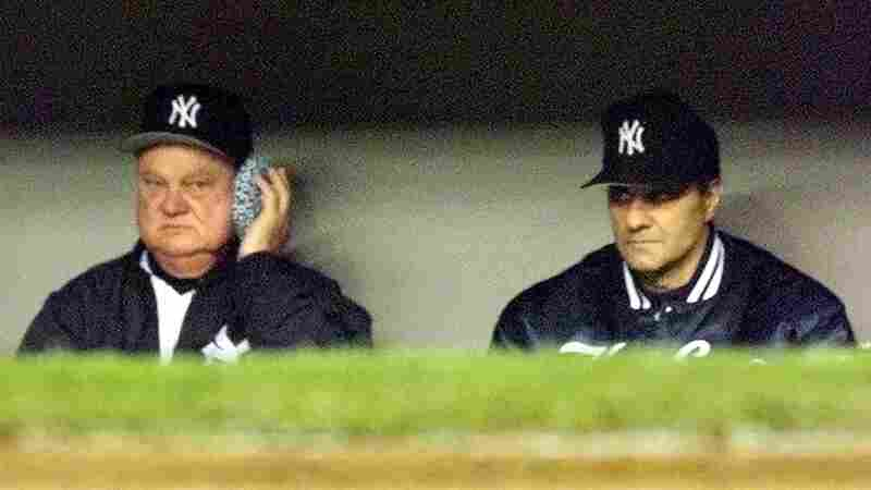 New York Yankees bench coach Don Zimmer holds an ice pack to his head as he sits next to manager Joe Torre. Zimmer had returned to the bench after being hit by a foul ball. Zimmer, a longtime baseball figure, has died at age 83.
